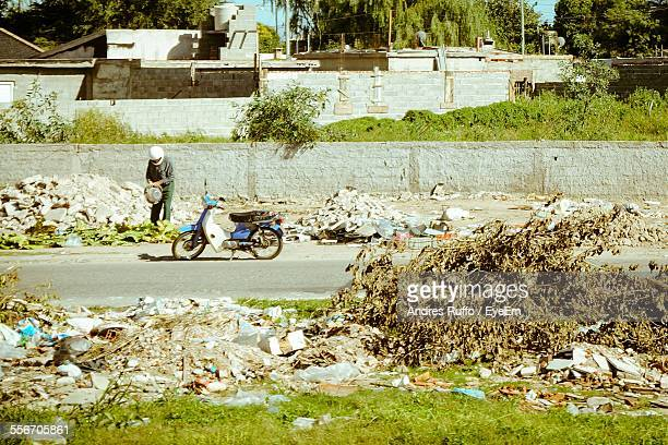 side view of a man walking on the road - andres ruffo stock photos and pictures