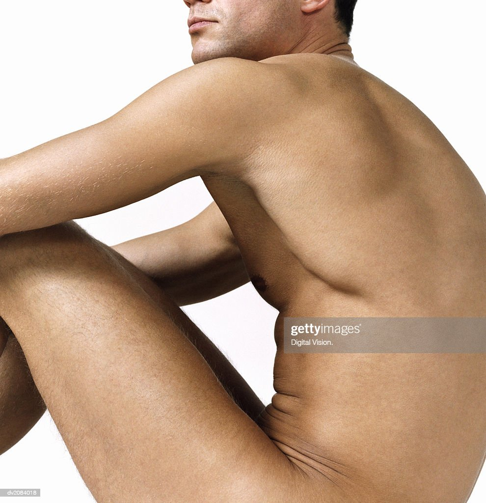 Side View of a Naked Man Sitting : Stock Photo