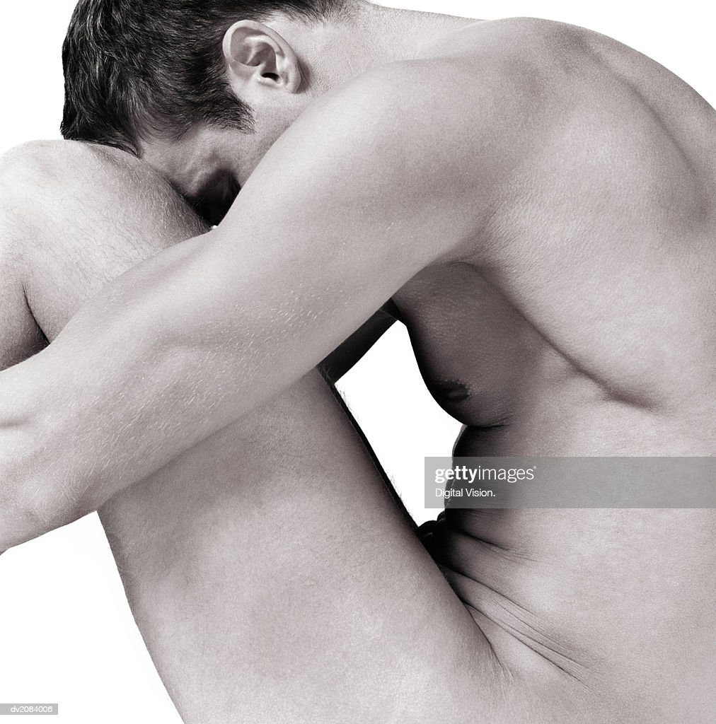 Side View of a Naked Man With His Hands Around His Knees : Stock Photo