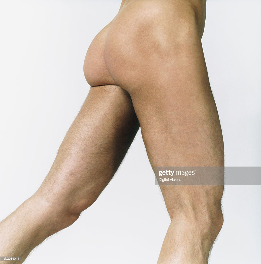 Side View of a Naked Man's Thighs : Stock Photo