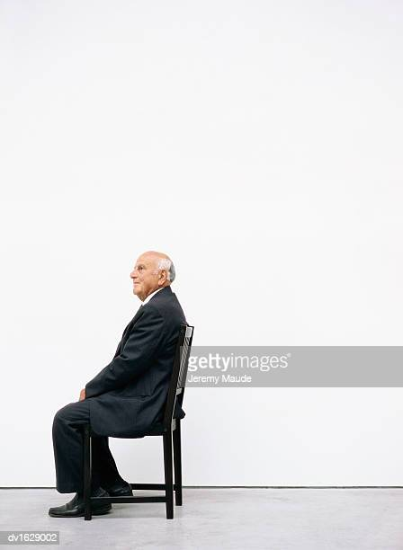 Side View of a Senior Man Sitting on a Chair