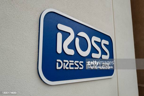 """Side view of a sign reading """"Ross Dress for Less"""" on the facade of Ross clothing store in Walnut Creek, California, December 15, 2020."""