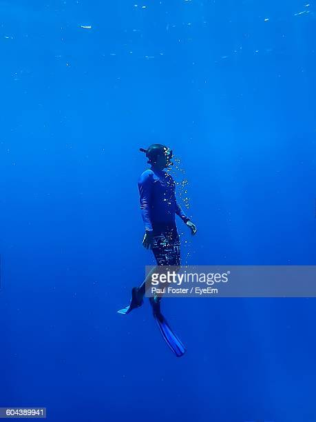 Side View Of A Snorkeling Underwater