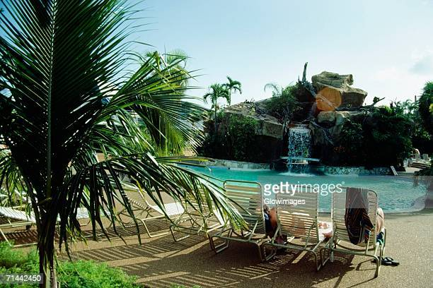 side view of a swimming pool at princess hotel, freeport, bahamas - freeport bahamas stock photos and pictures