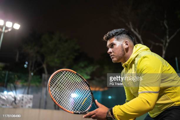 side view of a tennis player ready to play - tennis player stock pictures, royalty-free photos & images