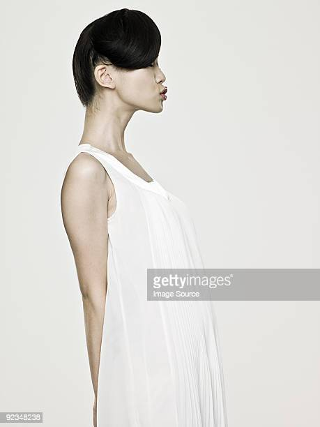 Side view of a young asian woman