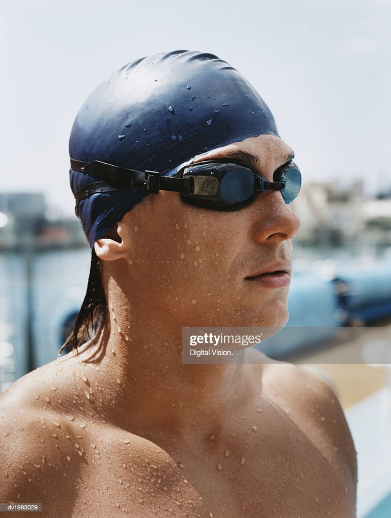 Side View of a Young Man Wearing Swimming Goggles and Cap : Stock Photo