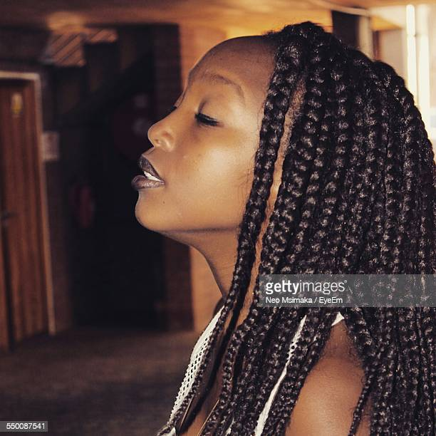 side view of african woman with closed eyes - thick black woman stock photos and pictures