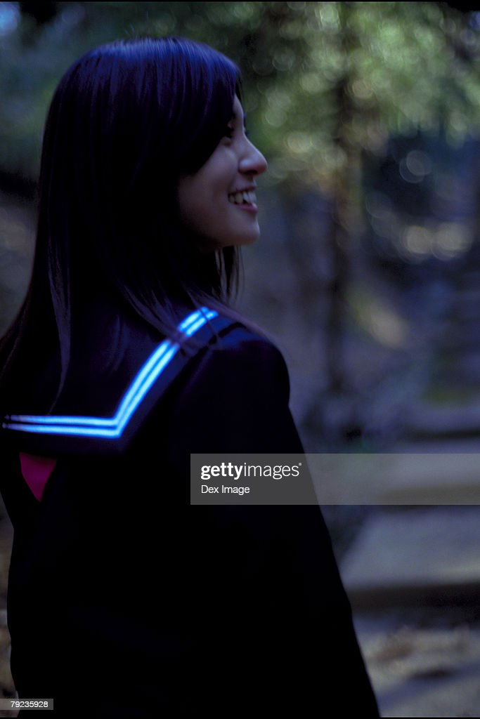 Side view of an Asian woman : Stock Photo