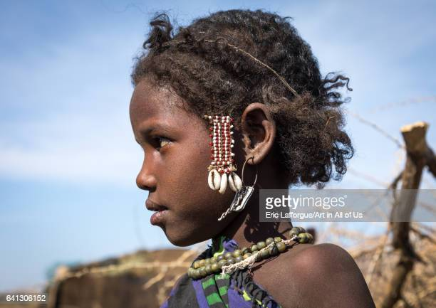 Side view of an Issa tribe child girl with traditional hairstyle on January 14 2017 in Yangudi Rassa National Park Ethiopia