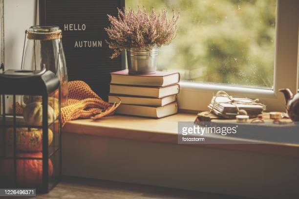 side view of autumn corner  against the window with hello autumn sign - embellishment stock pictures, royalty-free photos & images