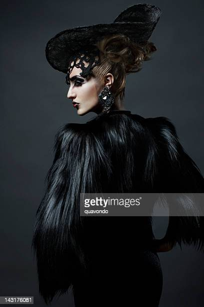avant garde fashion model in fur coat and hat, updo - haute couture stock pictures, royalty-free photos & images