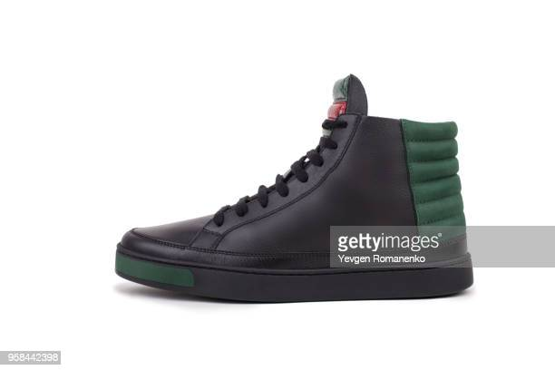 side view of black leather high-top sneaker, isolated on white background - sapato preto - fotografias e filmes do acervo