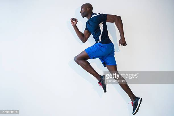 Side view of Black man running