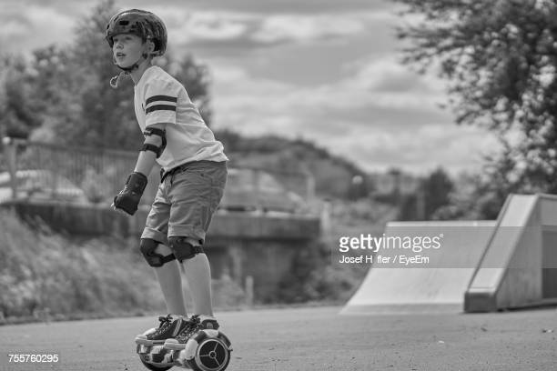 Side View Of Boy On Self-Balancing Board At Park