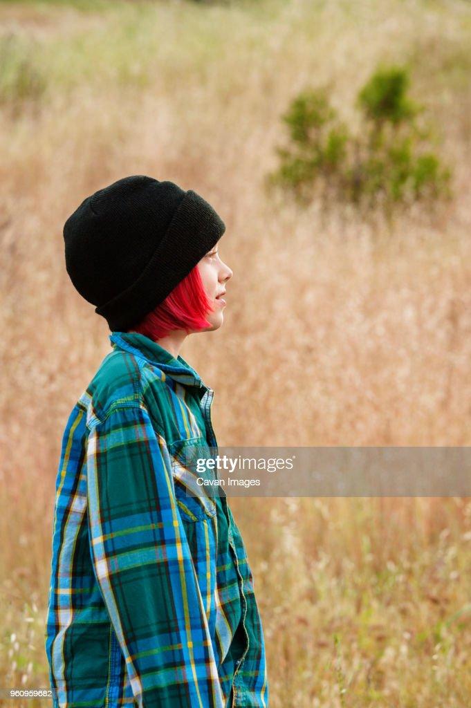 Side view of boy standing on field : Stock-Foto