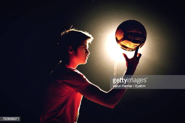Side View Of Boy With Ball