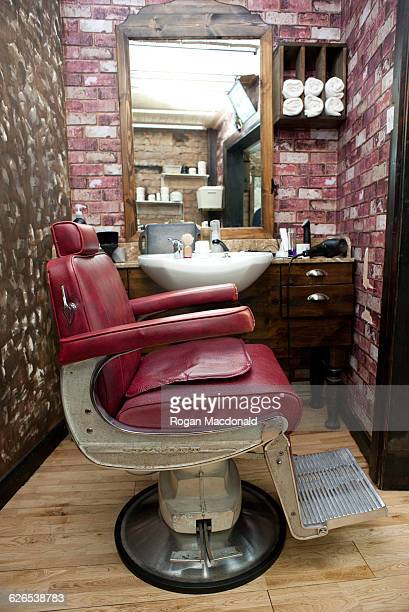 Side view of burgundy leather chair in barbershop