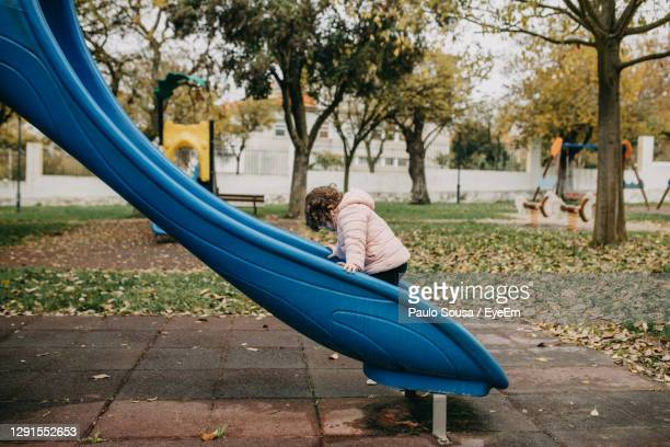 side view of child in park - side view stock pictures, royalty-free photos & images