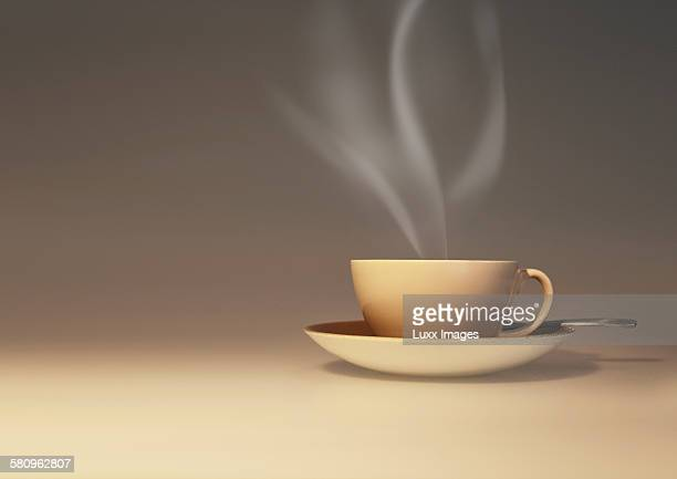 Side view of coffee cup with hot steam coming out