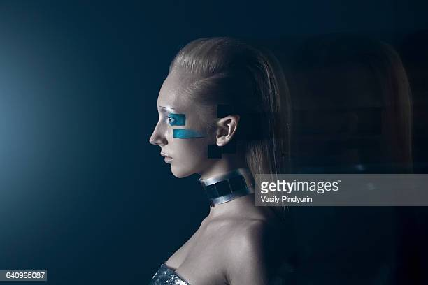 Side view of confident fashion model against blue background