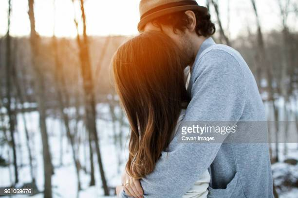 side view of couple embracing during winter - somerville massachusetts stock pictures, royalty-free photos & images