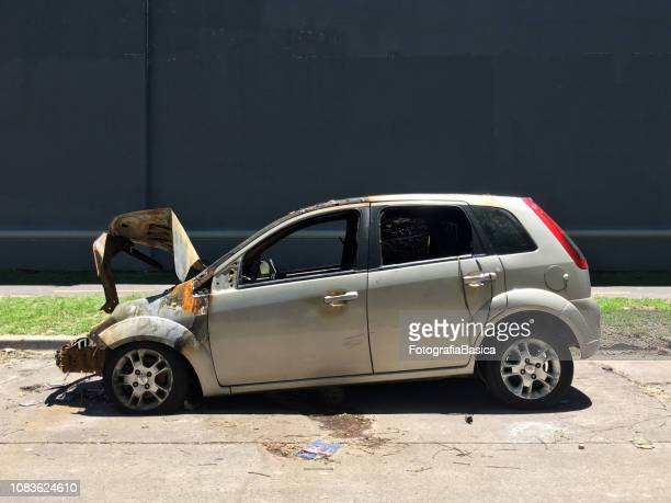 side view of crashed car - car crash wall stock photos and pictures