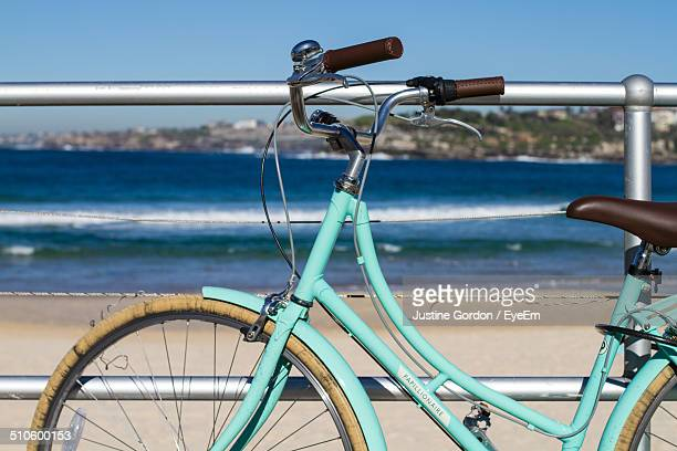 Side view of cropped bicycle against the beach