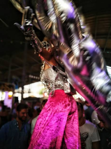 Side View Of Dancer Wearing Costume Dancing In City At Night