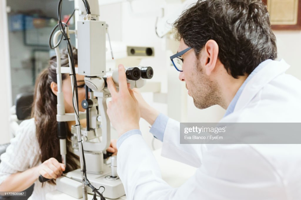 Cropped Hand Of Doctor Examining Woman High-Res Stock