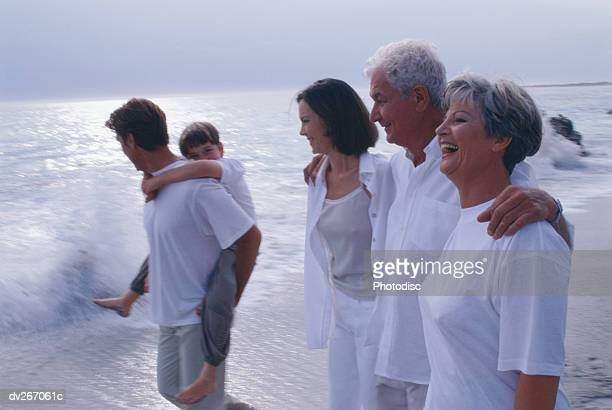 Side view of family on beach