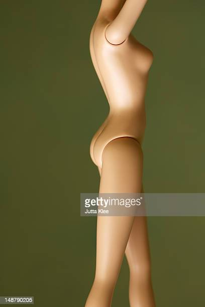 side view of fashion doll , mid section arms up
