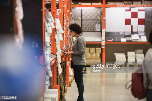 Side view of female customer shopping in hardware store