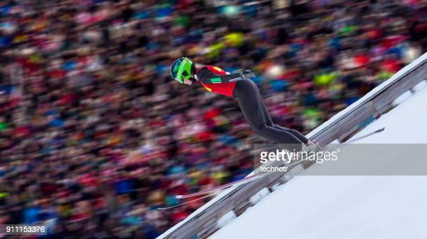 Side View of Female Ski Jumper Landing