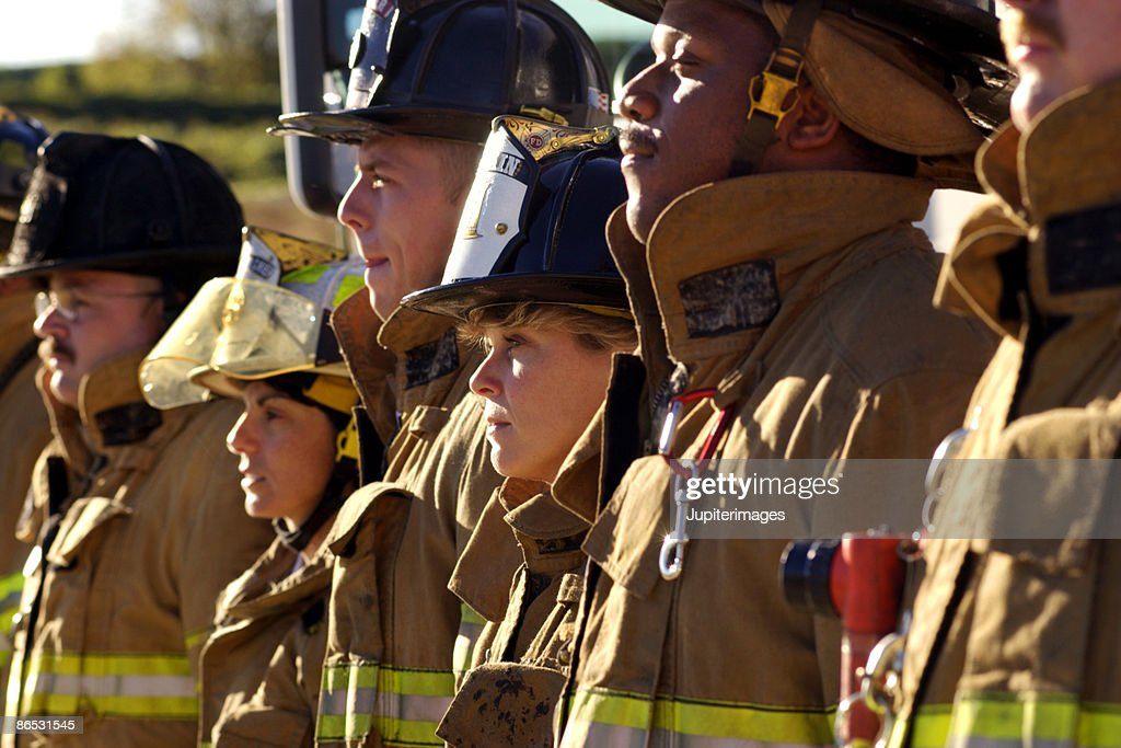 Side view of firefighters : Stock Photo