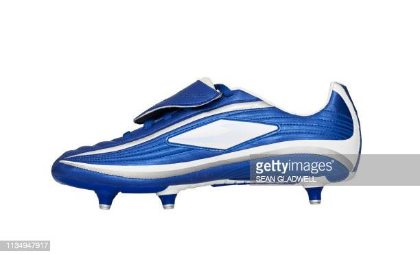 side view of football boot - cleats stock pictures, royalty-free photos & images