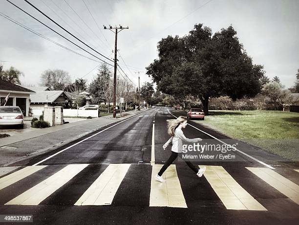 Side view of girl crossing street