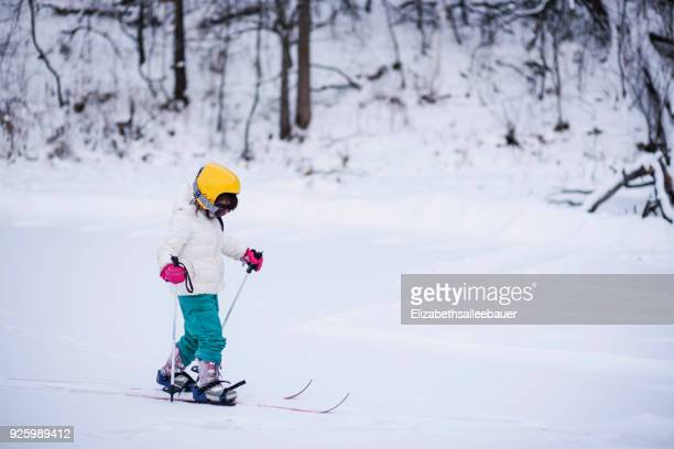 Side view of Girl skiing