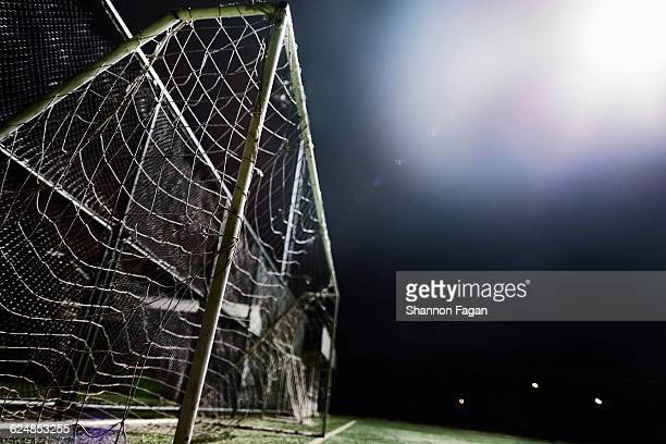 Side view of goal at night on sports field