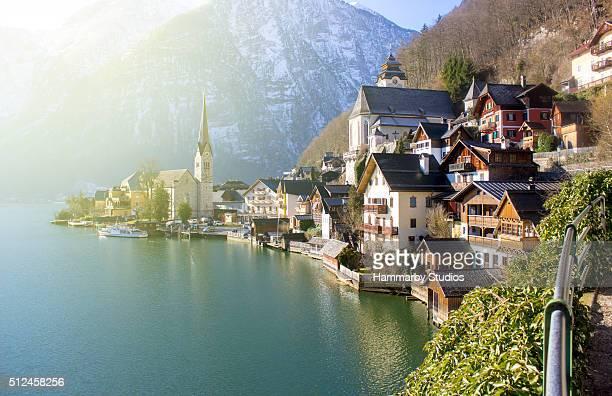 side view of hallstatt, austria in sunlight - hallstatt stock pictures, royalty-free photos & images