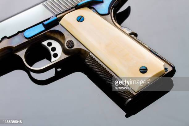 side view of hand gun pistol with gun magazine - trigger stock pictures, royalty-free photos & images