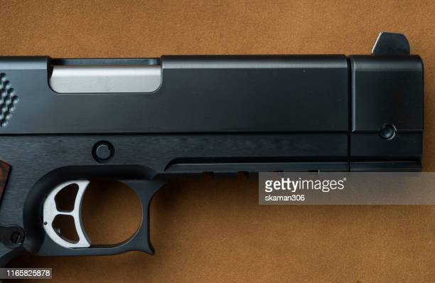 side view of hand gun pistol with gun magazine - ammunition magazine stock photos and pictures