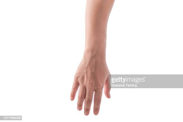 side view of human hand in reach out one's hand gesture isolate on white background , low contrast for retouch or graphic design - menselijke vinger stockfoto's en -beelden