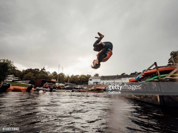 side view of jumping young man - somersault stock pictures, royalty-free photos & images
