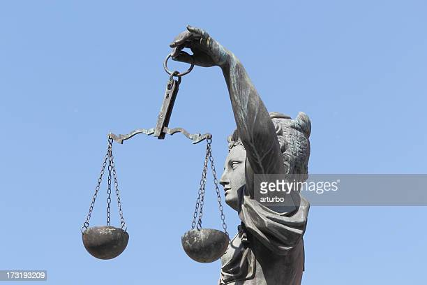 side view of lady Justice Justitia against perfect blue sky