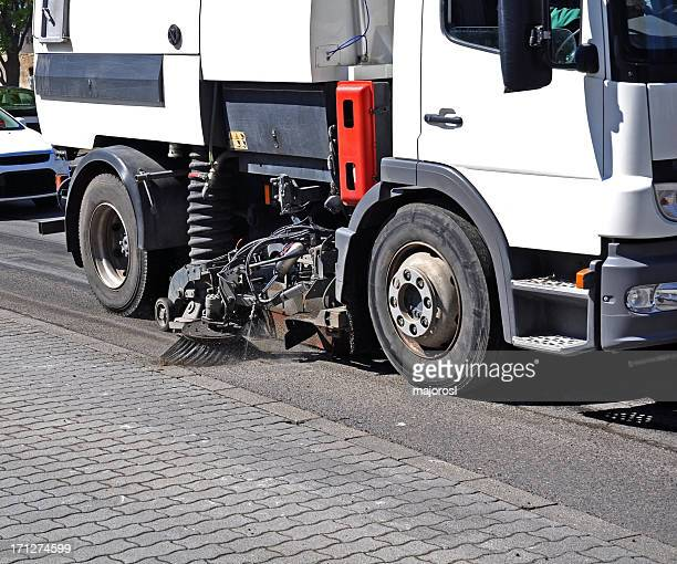 Side view of lower half of a street sweeper