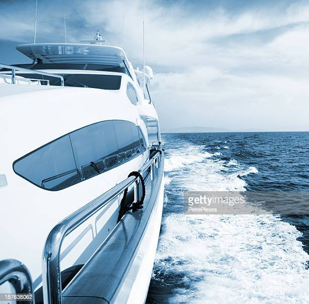 side view of luxury yacht sailing the sea - luxury yacht stock pictures, royalty-free photos & images