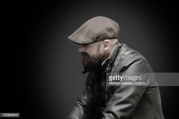 Side View Of Man Against Black Background