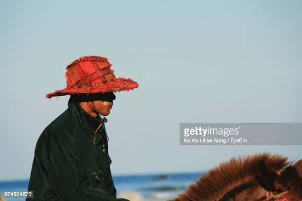 side view of man horseback riding against clear sky - ko ko htike aung stock pictures, royalty-free photos & images