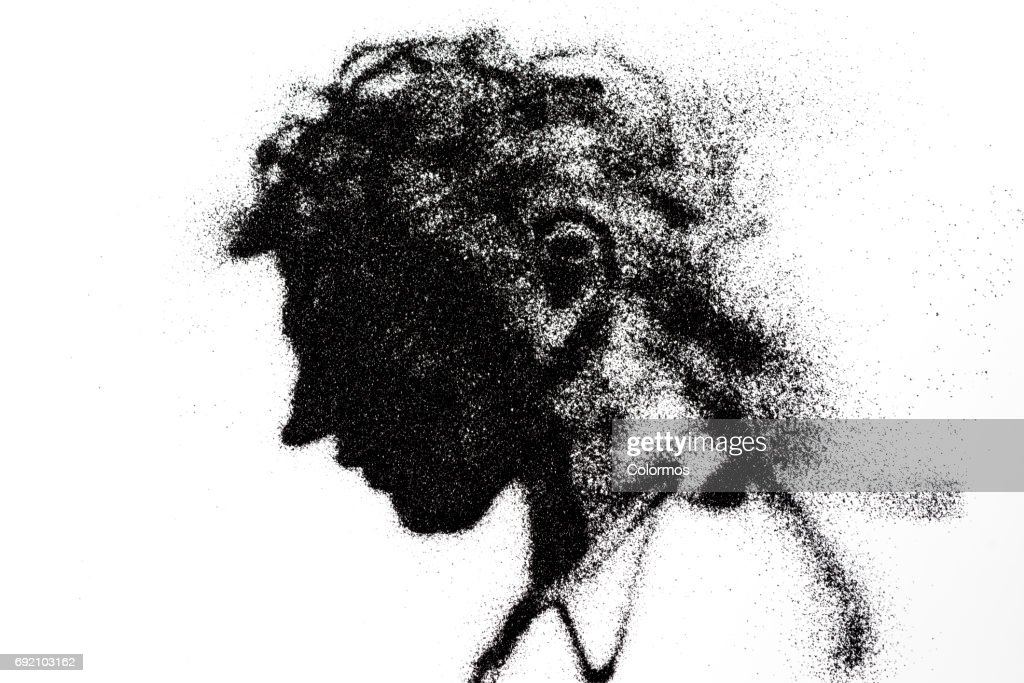 Side view of man looking down : Stock Photo